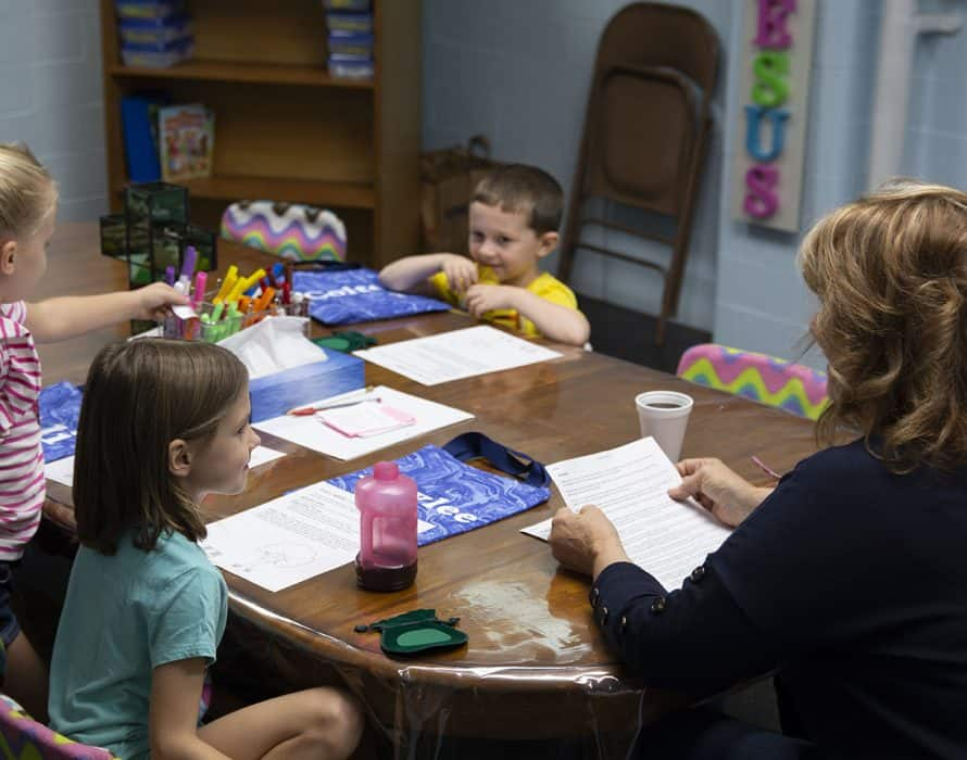 Children sitting at table during Bible Study